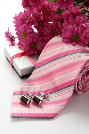 cufflink: Tie and cuff links with flowers over white Stock Photo