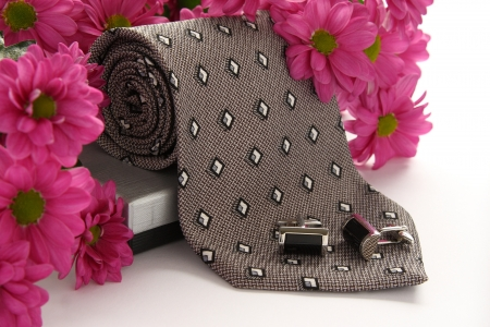 cuff links: Tie and cuff links with flowers over white Stock Photo