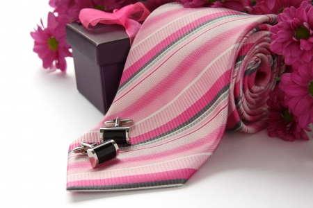 Tie and cuff links with flowers over white Stock Photo