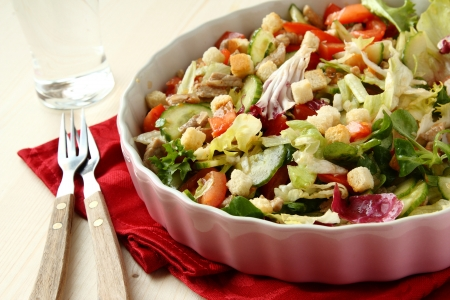 Salad with meat, cucumbers, tomatoes and croutons Stock Photo