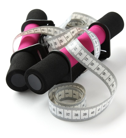 Black-pink soft dumbbell with handle strap and measuring tape over white