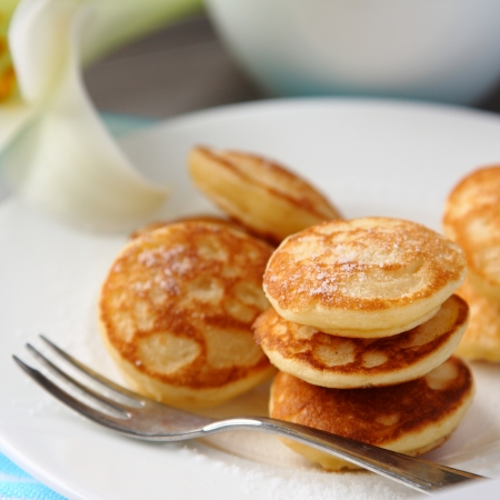 repast: Dutch mini pancakes called poffertjes, sprinkled with powdered sugar Stock Photo