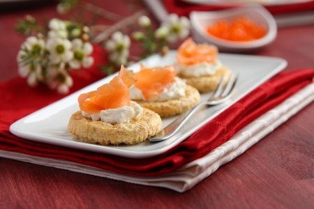 Canapes with oat bran cookies, smoked salmon and cream cheese
