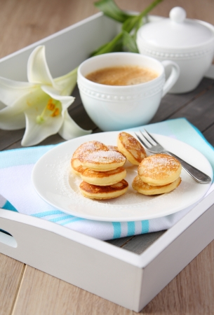 Dutch mini pancakes called poffertjes, sprinkled with powdered sugar photo
