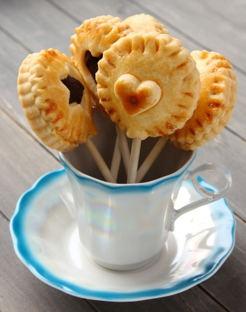 Homemade shortbread cookies pops with chocolate in cup photo