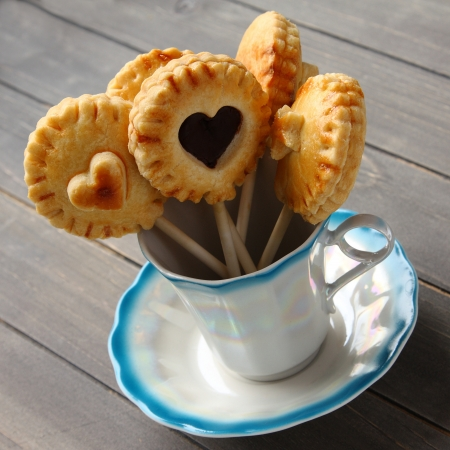 Homemade shortbread cookies pops with chocolate in cup