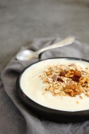 Natural yogurt with muesli in old gray bowl