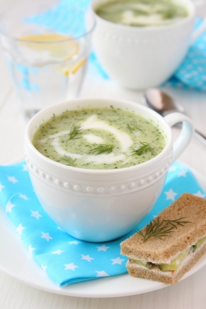 Cold cucumber-yogurt soup with dill, and cucumber sandwich Stock Photo