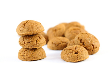 strooigoed: Pile of ginger nuts  pepernoten  isolated on white background  Typical Dutch candy
