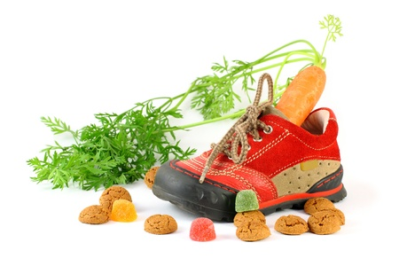 Childrens shoe with carrot voor Sinterklaas and pepernoten photo