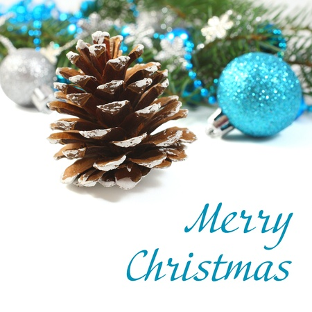 Christmas composition with pinecone and blue ball over white (with sample text) photo