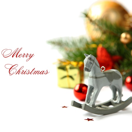seasonal greetings: Christmas composition with  wooden toy rocking horse (with easy removable sample text) Stock Photo