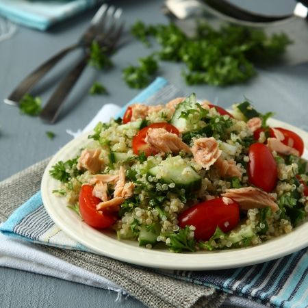 tabbouleh: Tabbouleh salad with quinoa, salmon, tomatoes, cucumbers and parsley Stock Photo