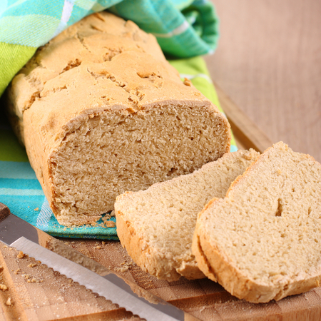 Fresh from the oven gluten free bread on a cutting board photo