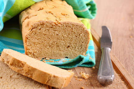 Fresh from the oven gluten free bread on a cutting board Imagens