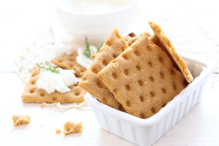 Gluten free crispbread with cream cheese and dill Stock Photo