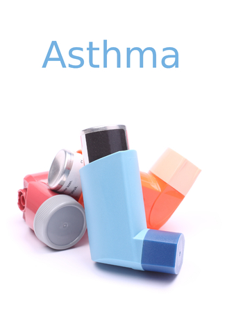 Asthma inhalers isolated over white with sample text photo
