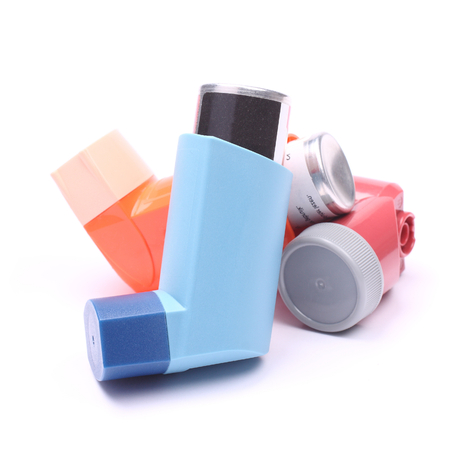 asthma: Asthma inhalers isolated over white