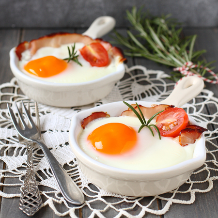 Fried egg in a ceramic pan for breakfast on wooden background