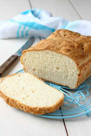 Homemade gluten free bread on blue metal grid Standard-Bild