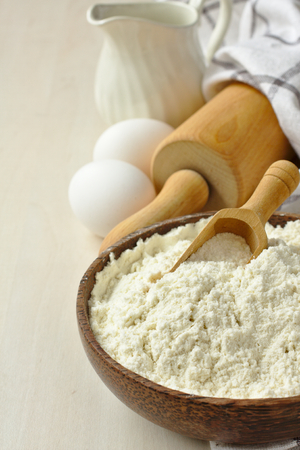 Homemade gluten free flour blend from rice flour, millet flour, potato starch and xanthan gum in wooden bowl met scoop Stock Photo