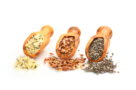 Superfoods in wooden scoops, one of the superfoods (seeds of chia, hemp and flax) photo