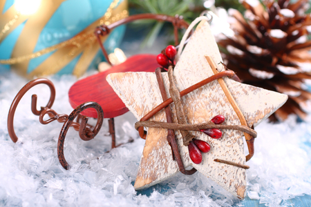 Christmas composition with wooden star and sleigh  on snow photo