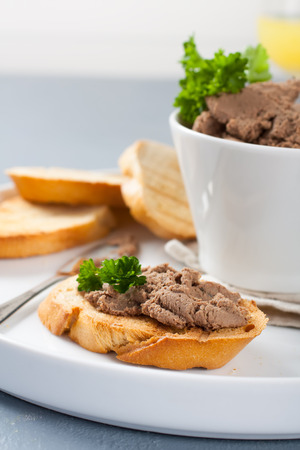 bawl: Chicken liver pate on bread and in bawl Stock Photo