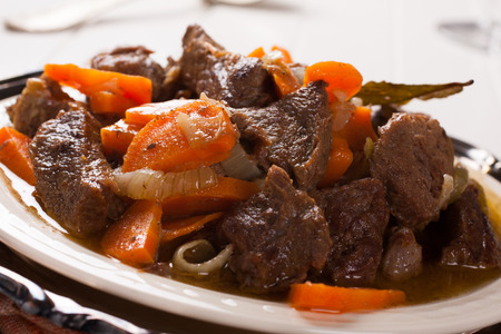 beef stroganoff: Plate of beef stroganoff with carrot Stock Photo
