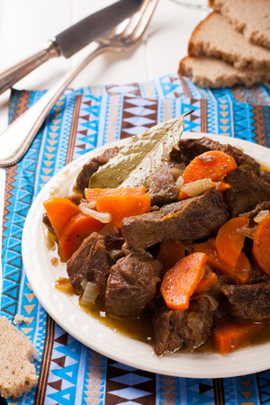 meat dish: Delicious bourguignon beef stew on white plate Stock Photo