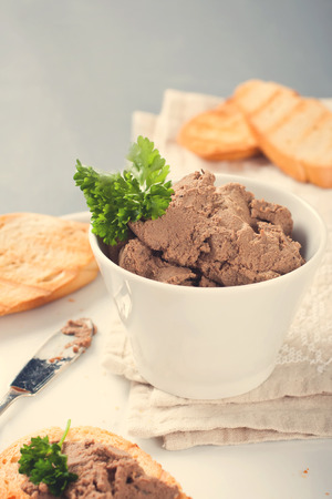 bawl: Healthy chicken liver pate with parsley in bawl Stock Photo