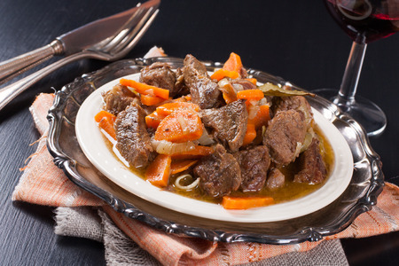 beef stew: Plate of beef stew with a green salad