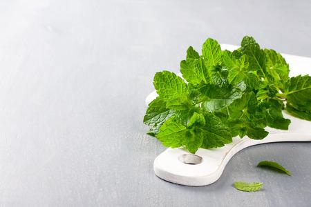 Fresh mint on white cutting board