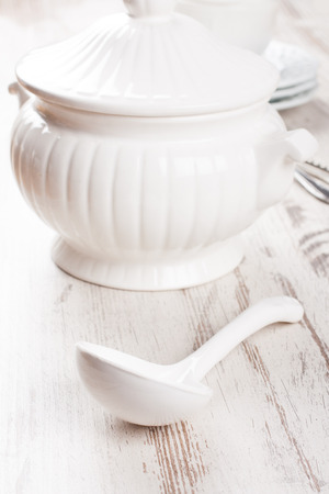 tureen: White soup tureen and ladle Stock Photo