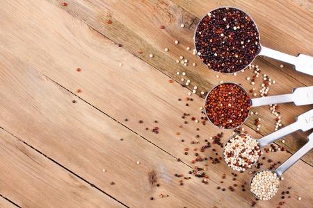 measuring spoons: Mix of quinoa grain in metal measuring spoons