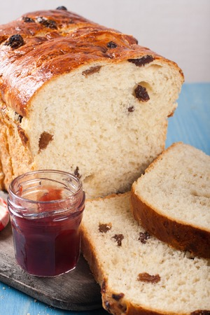 pone: Tasty sliced raisin bread and jam for breakfast. Healthy food background.
