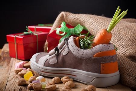 sinterklaas: Schoentje zetten, a traditional scene for the Dutch holiday Sinterklaas.  Selective focus.