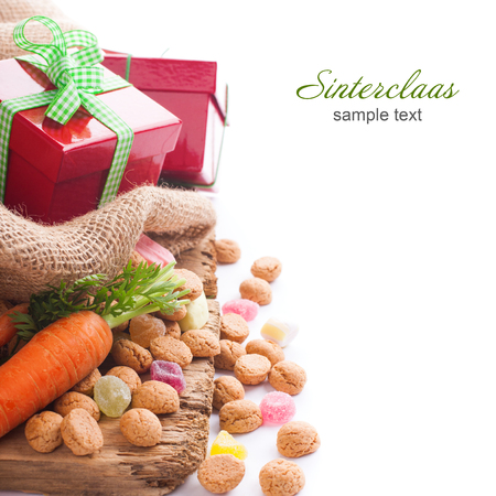 sinterklaas: Typical Dutch celebration: Sinterklaas with surprises in bag and ginger nuts, ready for the kids in december.  Holiday background with copy space for text.