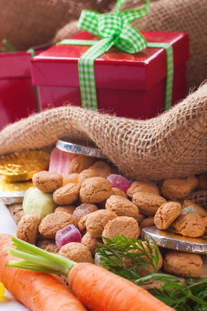 ginger nuts: Typical Dutch celebration: Sinterklaas with surprises in bag and ginger nuts, ready for the kids in december.  Holiday background.