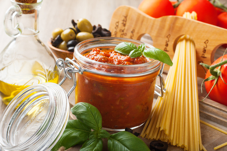 Ingredients for spaghetti with tomato sauce on wooden background. Italian healthy food background. Standard-Bild