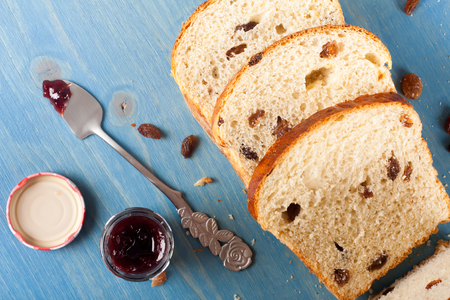 pone: Tasty sliced raisin bread and jam for breakfast. Healthy food background. Tope view. Stock Photo