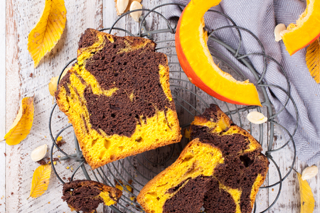 homemade cake: Homemade marble chocolate pumpkin cake on rustic background. Healthy food concept. Top view.