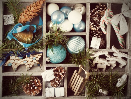 adornos navideños: Christmas decoration with christmas tree branches in wooden box. Winter holidays concept.  Retro style toned.