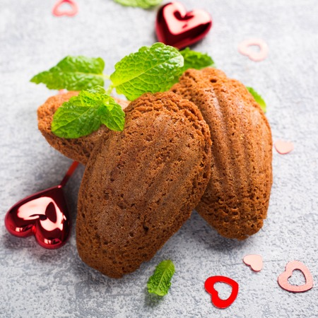 the madeleine: Homemade chocolate cookies Madeleine with mint and Valentines day decorations. Holidays food.