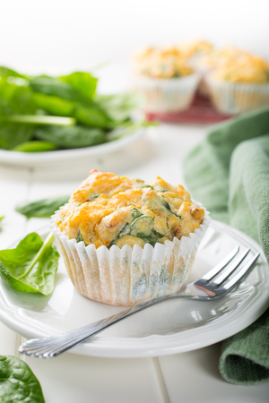 spinach: Muffins with spinach, sweet potatoes and cheese on white background. Healthy food concept. Stock Photo