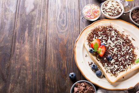 chocolate sprinkles: Dutch breakfast, slice of bread with hagelslag chocolate sprinkles and berries. Copy space.