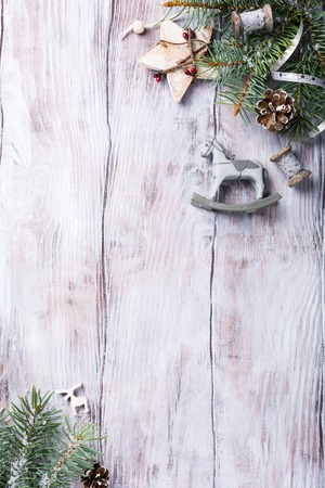text space: Christmas background with fir tree and decorations. Old wooden board. Top view with copy space for text.