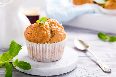 Delicious homemade coconut cinnamon muffin on marble coasters. Healthy food concept. Stok Fotoğraf
