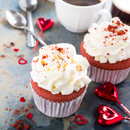 Delicious red velvet cupcakes on rusty old metal background. Valentines Day food.
