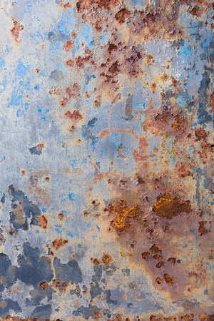 Blue peeling paint and rusty old metal background, texture. Vertical. Stock Photo